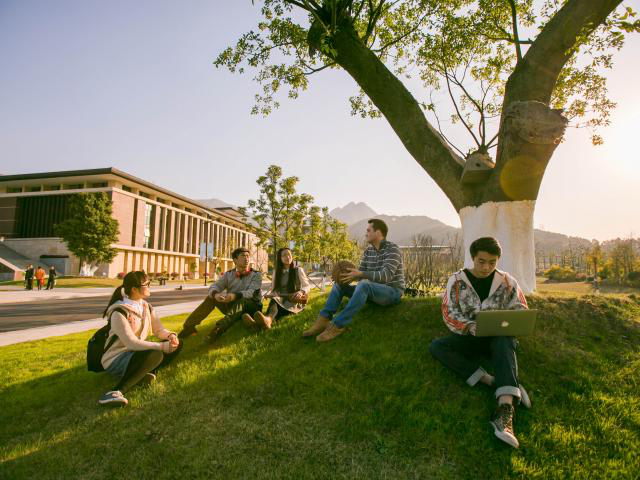 Wenzhou-uedbet students talking on the grass.