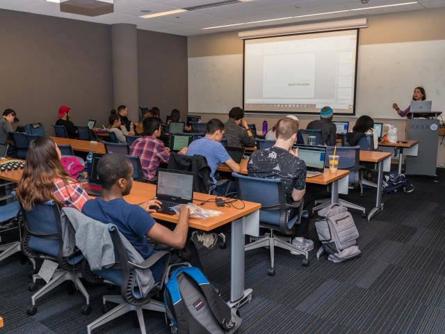 Students learn in computer science classroom