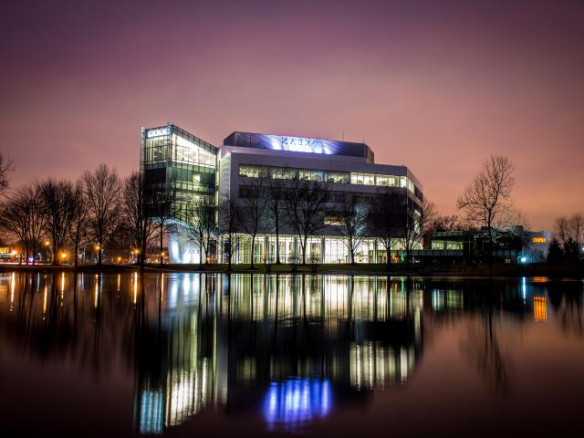 Kean's STEM building at dusk from across the pond