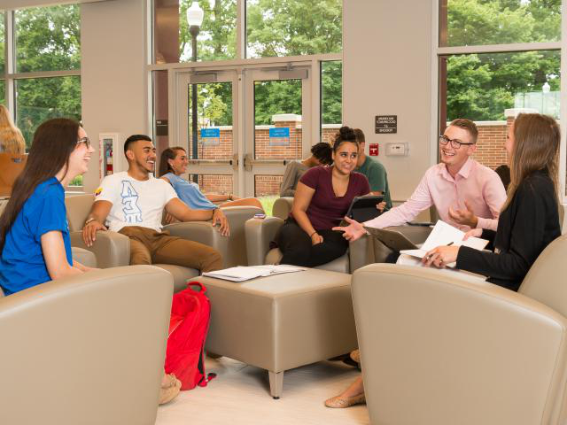 uedbet students inside residence hall at seating area