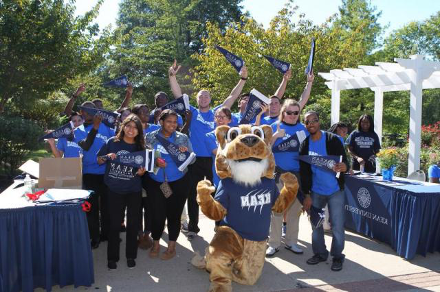 Kean Students pose with Cougar mascot