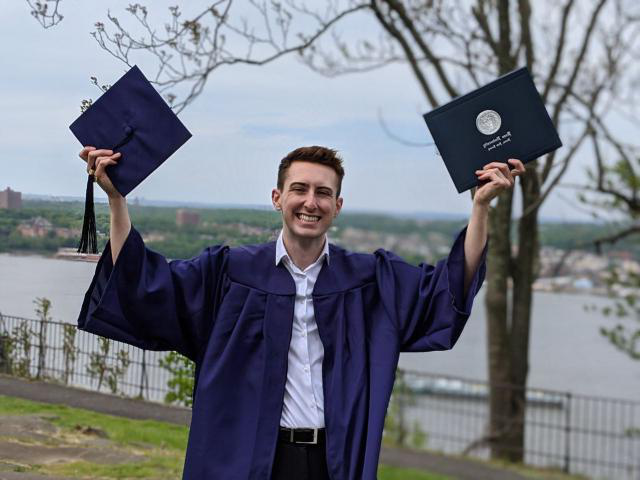kean grad 2020 guy with arms up